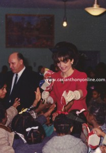 Jacqueline Kennedy hands out lollipops at Junior Village.