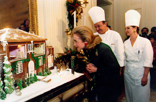 Hillary Clinton looks into the Gingerbread House modeled after her childhood home.
