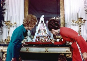 Pat Nixon and daughter Julie inspect the first of the White House Gingerbread houses.