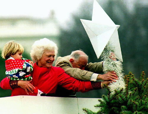 Barbara Bush Placing The Star Atop The National Christmas Tree.