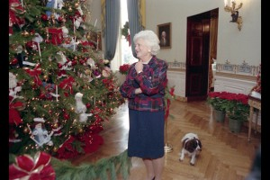 Barbara Bush with her dog Millie looks over the Blue Room tree.