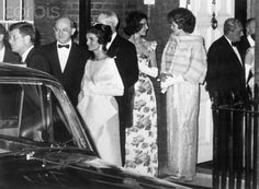 The Kennedys leaving the London residence of the First Lady's sister on their way to dinner at Buckingham Palace. (AP)