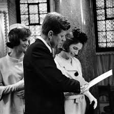 The President and Mrs. Kennedy during the baptism ceremony of the First Lady's niece. (original source unknown)