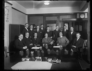 Charlie Forbes, seated at center, holding a meeting with his Veterans Bureau staff. (Library of Congress)