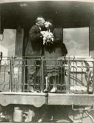 Lou Hoover receiving a kiss from her husband during his 1932 campaign - and the flowers she was seemingly over handed. (HHPL)
