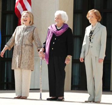 Former First Ladies Hillary Clinton, Barbara Bush and Rosalynn Carter all wearing pants at the George W. Bush Presidential Library dedication.