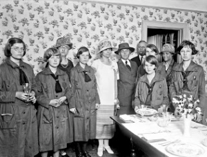 "Lou Hoover, in her role as Girl Scout president, with First Lady Grace Coolidge visiting the ""Little House."" (LC)"