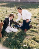 The Reagans play with one of their dogs at the Yearling Row Ranch just before selling it. (Getty)