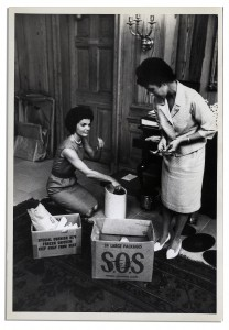Mrs. Kennedy with Lorraine Pearce sorting through donated items. (Life)