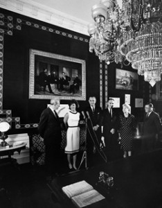 In there Treaty Room, Mrs. Kennedy with Vice President Johnson and Senate leaders during a ceremony during which they presented a donated chandelier that had been in the Capitol but was once in the White House. (JFKL)