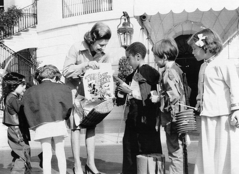 Betty Ford welcomes child guests for her 1974 Halloween Party on the South Lawn.  (GSRFPL)