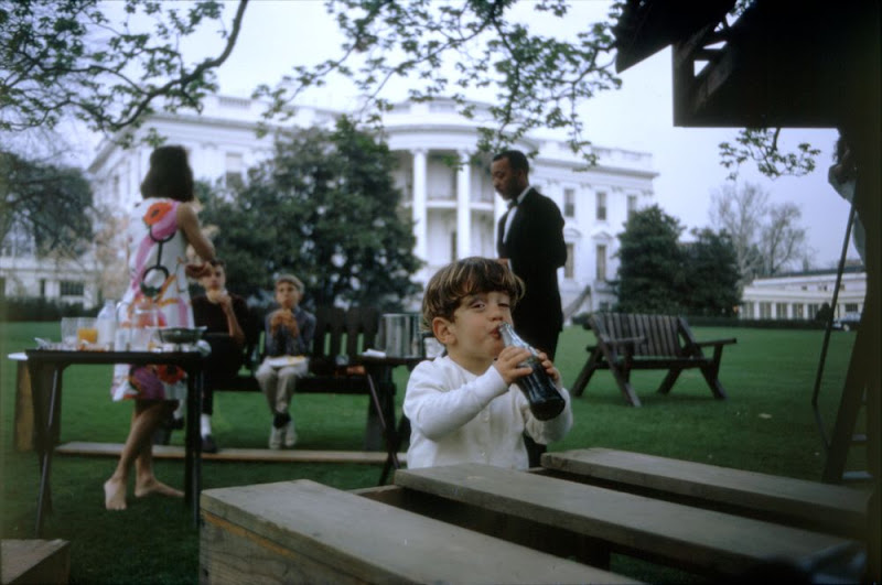 John Kennedy, Jr. enjoying a Coca Cola on the South Lawn,1963. (JFKL)