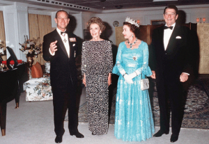 "The Reagans with England's Queen Elizabeth and Prince Philip aboard the yacht Britannia, the latter couple hosting an anniversary dinner for the former there. The piano at left was played while the First Lady again serenaded her husband with ""Our Love is Here to Stay."" (britain-magazine.com)"
