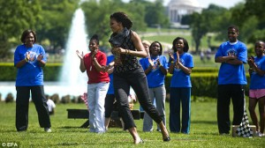 The First Lady exercising with children on the South Lawn. (WH)