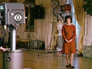 Facing a CBS camera, Jacqueline Kennedy narrating the story of her White House restoration for the public, during her televised tour of the rooms showing her efforts. (CNN)