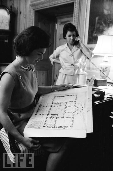Mrs. Kennedy in the curator's office looking over a blueprint of the mansion. (Life)
