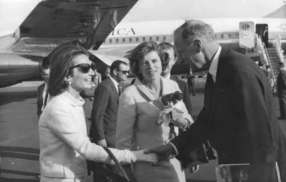 As part of the presidential entourage to Ireland, Radziwill greets an Irish government official, as Eunice Kennedy Shriver looks on.