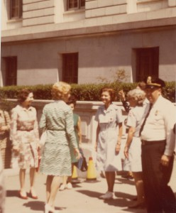First Lady Pat Nixon, in blue, bidding farewell to Second Lady Betty Ford, in the blue Red Cross uniform, 1974. (National Archives)