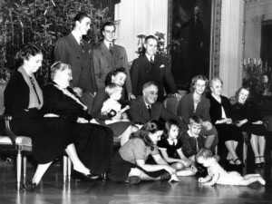 The FDR family gather for Christmas 1939 in the East Room. (FDRL)