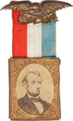 """A Lincoln """"badge"""" with ribbon that was pinned to the outside of clothing."""