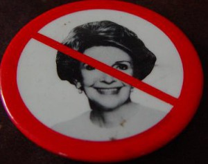 """An anti-Reagan button using the international symbol for """"no."""" (private collection)"""