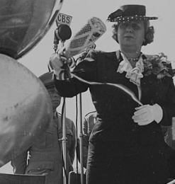 Bess Truman with a champagne bottle intended to christen a plane. (National Archives)