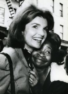 A voter embraces Jackie Kennedy Onassis during her appearance at a Harlem event during the 1980 election. (pinterest)