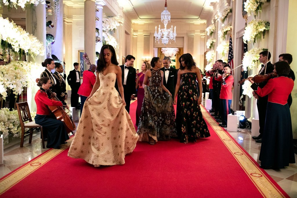 Malia Obama, far left, followed by her sister Sasha and mother, First Lady Michelle Obama as formal guests at the state dinner for the Canadian Prime Minister.