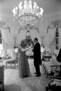 Susan Ford laughs with her father before serving as hostess for a state dinner on behalf of her mother, who was recuperating from surgery. (GFPL)