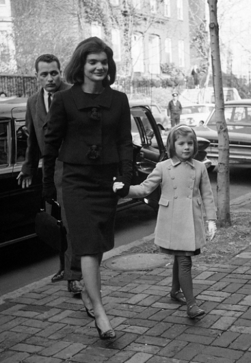 The recently widowed Jacqueline Kennedy arrives with her daughter Caroline from the White House to their new temporary Washington home, December 6, 1963. (AP)