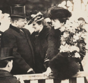 Alice Roosevelt speaks with her father, her stepmother between them, at the ship dedication. (LC)