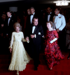 President Nixon escorts his wife Pat and former First Lady Mamie Eisenhower. (Life)