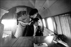 Jackie Kennedy and her husband on his campaign plane; she successfully urged changes in her travel itinerary. (pinterest)