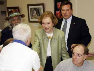 Rosalynn Carter, watched by her agent as she campaigned in a senior center. (pahrumpvalleytimes.com)
