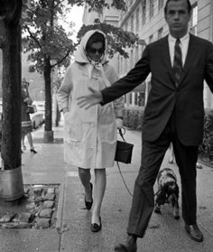 The widowed Jackie Kennedy walking her dog in New York while her Secret Service agent blocks a photographer. (Pinterest)