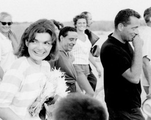 Jackie Kennedy on her 1962 Italian holiday with Clint Hill in black shirt. (Getty)