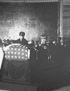 Florence Harding places her mourning ribbon on the casket of the Unknown Soldier. (NFLL)