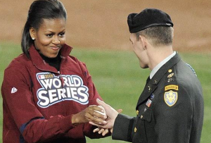 The First Lady handed the ball she tossed at the 2010 World Series from a member of the US Armed Forces. (Getty)