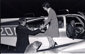 Jimmy Carer helps his wife Rosalynn out of a prop plane after one of her many regional fact-finding missions around the country during the 1976 campaign. (alamy)