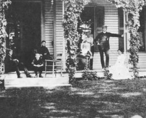 Lucretia Garield, seated at center in black, with family members on the front porch of their home, at a moment when it was not the center of attention during the 1880 campaign. (Garfield NHS)