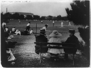 The Coolidges and their son John take in a local ballgame on the Ellipse, behind the White House. (LC)