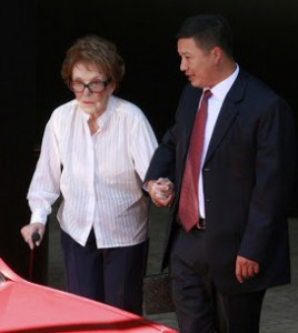 Presidential widow Nancy Reagan being escorted by Secret Service agent Richard Kyle Bui. (ocweekly.com)