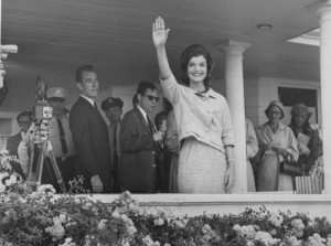 From the front porch of her in-law's home in Hyannis, Massachusetts, Jackie Kennedy waves to crowds the day after her husband won the nomination at the 1960 Democratic Convention in Los Angeles. (Tumblr)