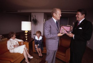 Reagan presented a peace pipe as a birthday gift to Ford on July 16, 1980 at the Republican convention, as Betty Ford and Nancy Reagan confer in background.(Kennerly/Getty)