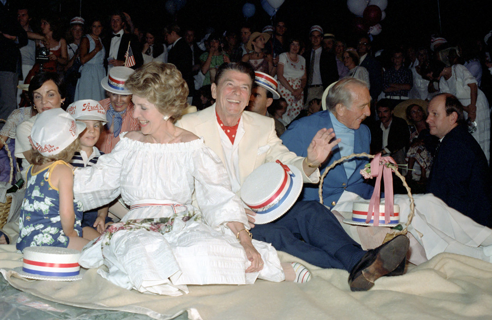 The President helped make Nancy Reagan's first Fourth of July birthday as First Lady a relief from her anxieties. They take in fireworks with friends on the White House South Lawn, 1`981. (RRPL)
