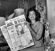 The morning after her husband was nominated at the 1960 convention, Jackie Kennedy displayed a newspaper with the headline announcing the news. (Pinterest)