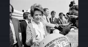 Nancy Reagan signs a balloon as she and her husband arrive for the 1976 Republican convention. (Politico)