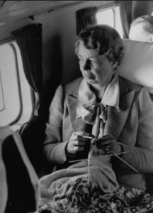 Eleanor Roosevelt knitting on a plane. (Getty)