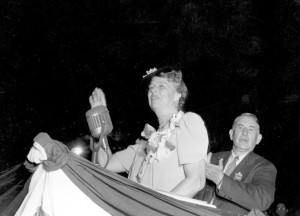 Mrs. Roosevelt quiets the cheers to begin her speech. (Corbis)