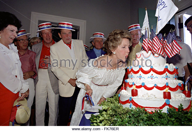 Nancy Reagan blows out her July Fourth birthday cake candles. (RRPL)